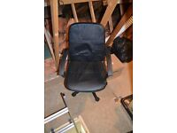 Black leather effect computer chair.