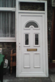 White upvc door with small obscure glazed fanlight, and two slit panels plus detail in them