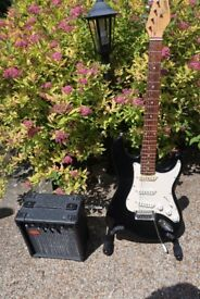 Electric Guitar, Stand, Amp and Lead. In great condition