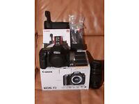 Canon 7D camera with battery grip extra batteries and lens