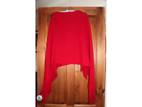 Red wool poncho with tassel detail, medium size