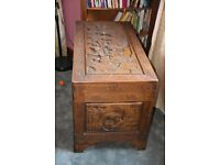 Oriental camphorwood chest with carved designs