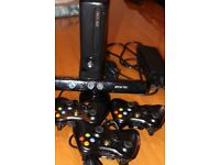 XBOX 360 and 27 Games and kinect sensor and 3 controllers