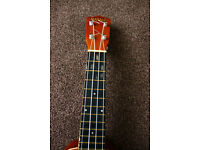 Mahalo soprano ukulele fitted with piezo pickup and aquila strings