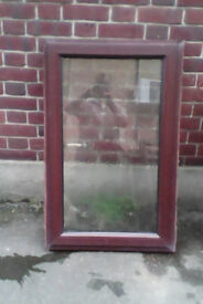 Rosewood upvc window with one opening window 635 wide X 1010 mm