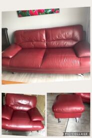 Red sofa armchair and footstool