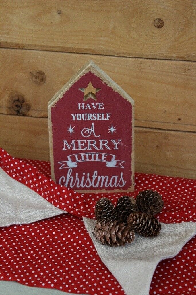 A wooden plaque Christmas decoration
