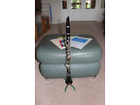 A well loved ARTLEY (17S) Bb clarinet with case, stand and 3 music books.