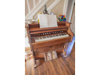 Home needed for this antique Reed Organ