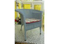 Lloyd Loom armchair with removable padded cushion