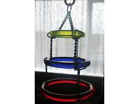 two perspex parrot toys