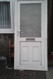 White upvc door with obscure glazing to the top panel,..