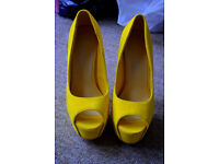 Yellow high heels size 4