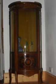 Antique French style display cabinet with serpentine shaped front in mahogany