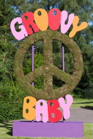 A Giant 'Groovy Baby' Austin Powers Piece Symbol - perfect for a party or event