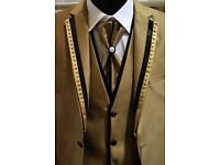 Men's 4 piece suit.White,black,blue,gold,silver.Sizes 38 to 46.£95 EACH.Trade discount for bulk buy