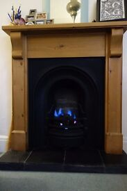 Elegant gas fire and antique pine surround