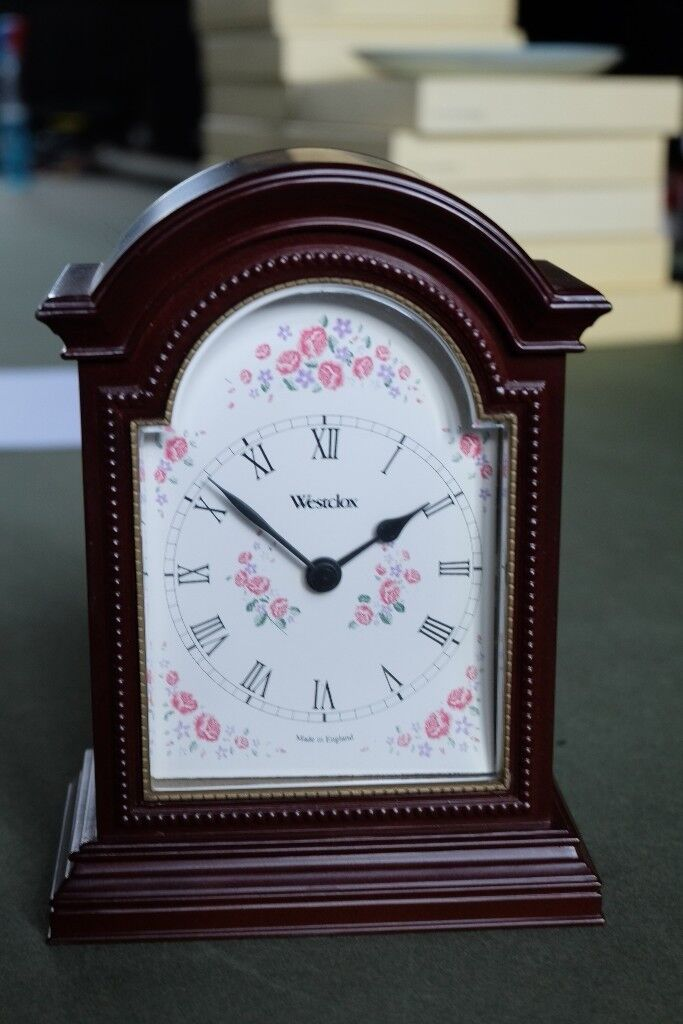 Vintage Westclox mantle clock with floral face.
