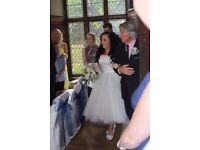 Beautiful size 12 designer wedding dress for sale