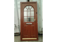 Light Oak upvc and composite door complete with frame and one key,.