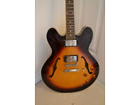 Vintage VSA535 (Vintage Tobacco Sunburst) with thick padded carry case