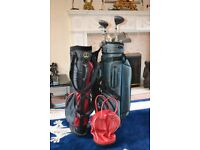 Set of steel shaft folf clubs, 2 bags, and golf ball bag