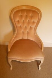 Spoon backed low bedroom chair