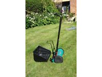 Almost new Bosch push along lawn mower. Used twice, ideal for small garden