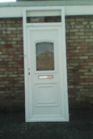 White upvc door with lovely patterened and obscure glazed panel