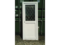 White upvc door with diamond design to the clear top panel