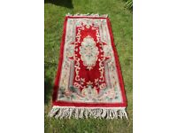 Wool rug, reds and beiges