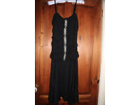 Black knee length cocktail dress with diamante embellishments, size 12/14