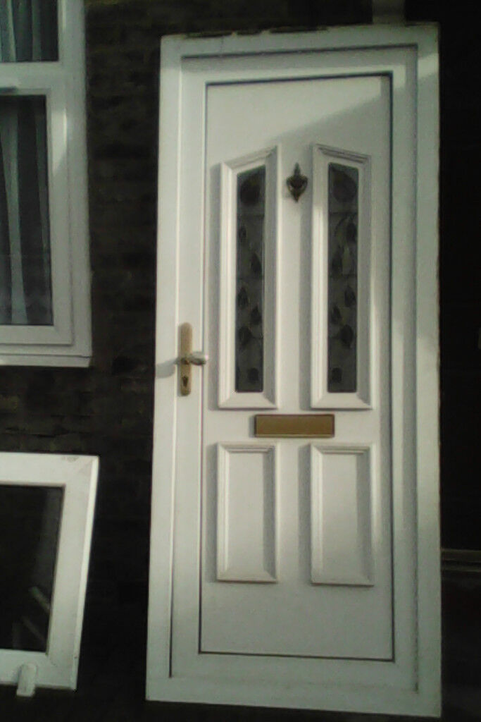 White upvc door with two rose leaded glass panels