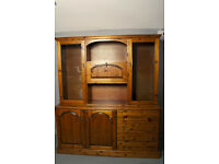sideboard dresser unit, base has four large draws large cupboard with two doors, glass doors on top