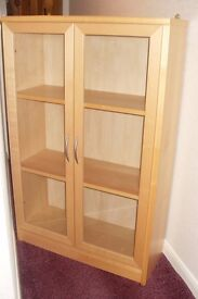 Mid Height Bookcase with glass doors in solid light Maple wood.