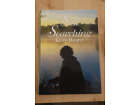 """Signed copy of """"Still searching"""" by Terry Hearn."""