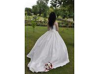 Beautiful swarovski crystal covered princess style corset top wedding dress.