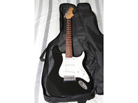 Electric Guitar plus soft bag, spare strings, capo and cable