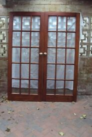 Pair of lazed hardwod doors excellent condition heavy brass hinges and knobs