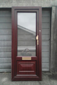 Brown UPVC door with clear glazed top glass,... with handle and one key