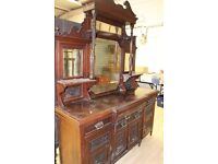 Victorian mirror backed dresser very big with heavy carving to drawers and cupboards
