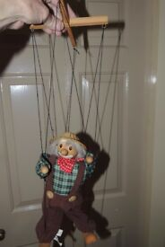 A wooden string puppet in excellent condition