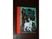Hardback copy of Knitbone Pepper Ghost Dog by Claire Barker