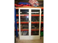A pair of great quality glazed wooden doors
