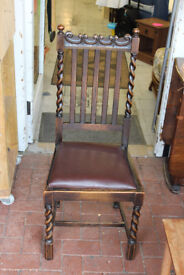 Three solid wooden carved chairs and table included