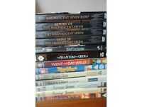 stack of DVD's various films and TV programmes, Terry and June, Dad's Army, Magnificent 7,