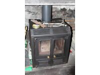 multi fuel stove with back boiler. 3 yrs old.great condition.selling as now have lpg heating