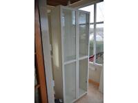 Three tall IKEA BILLY Cabinets/Wall Units, one glazed