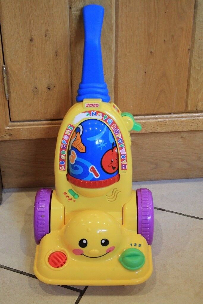 Fisher price push along hoover, vacuum cleaner