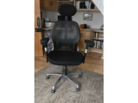 Black and silver office/gaming chair on castors very good condition
